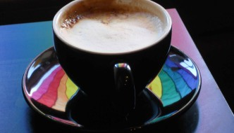 Coffee Cup at Wicked Grounds With Reflected Pride Rainbow