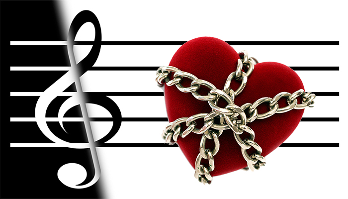 black and white music staff with red heart in chains
