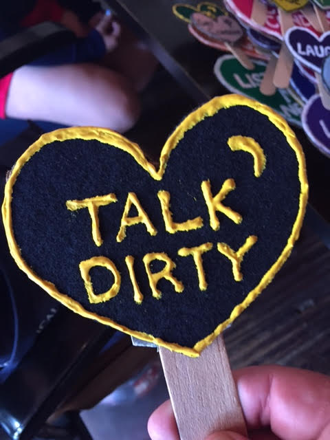 "Valentine heart sign reading ""Talk Dirty"""
