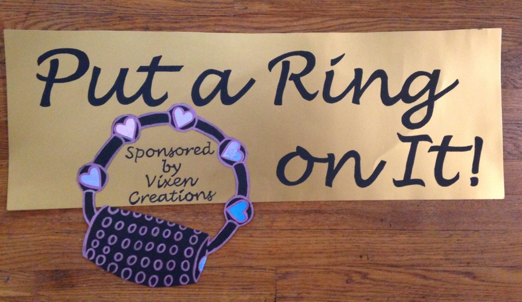 "Sign reading ""Put a Ring on It -- Sponsored by Vixen Creations"""
