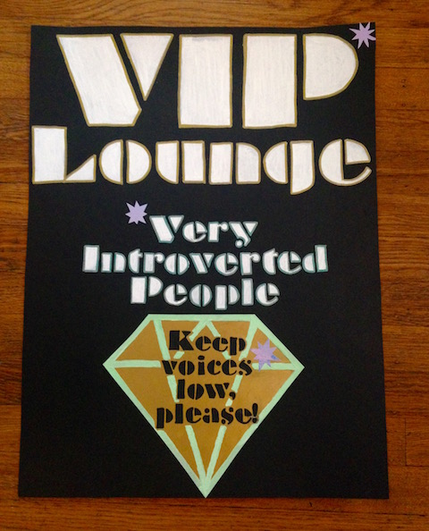 "Sign reading ""VIP Lounge: Very Introverted People. Keep voices low, please."""